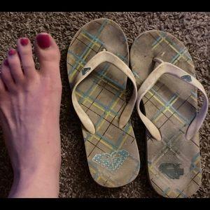 EXTREMELY worn flip flops.